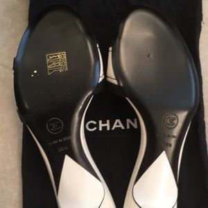 CHANEL Shoes - NIB Chanel White Mule Logo Slides size 38H 381/2
